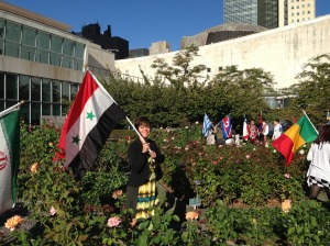 Flag-bearer for Syria at the UN International Day of peace, 2013.